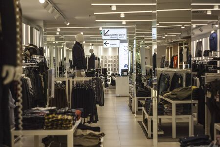Interior of a clothing store with many tipes of dresses