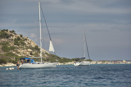 Villasimius sea and coast with sailboats 스톡 콘텐츠 - 133425860