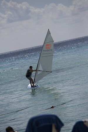 BAYAHIBE, DOMINICAN REPUBLIC 13 DECEMBER 2019: Windsurfer on caribbean sea