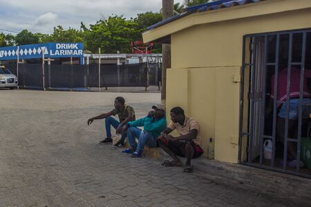 BAYAHIBE, DOMINICAN REPUBLIC 21 JANUARY 2020: Dominican people sitted in the street 報道画像