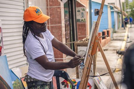 BAYAHIBE, DOMINICAN REPUBLIC 21 JANUARY 2020: Dominican painter street artist in Bayahibe