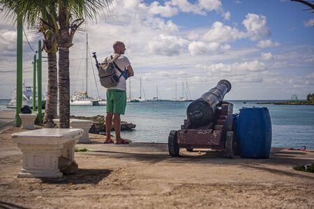 BAYAHIBE, DOMINICAN REPUBLIC 21 JANUARY 2020: Traveler looks at the sea in Bayahibe in the Dominican Republic