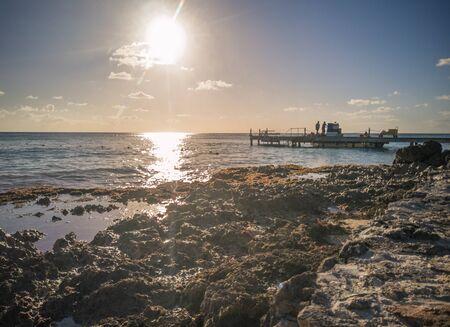 Sunrise on a pier in the sea In Bayahibe, Dominican Republic