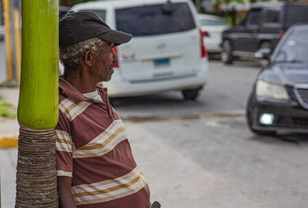 BAYAHIBE, DOMINICAN REPUBLIC 26 JANUARY 2020: Old alcoholic drunkard on the street in Dominican Republic