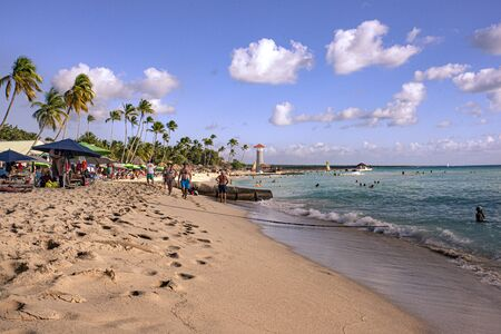 BAYAHIBE, DOMINICAN REPUBLIC 21 JANUARY 2020: Dominicus beach, Bayahibe shot full of tourists during the afternoon