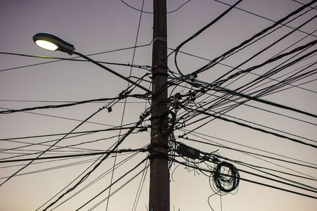 Trellis with electric cables unsafe in Dominican Republic 版權商用圖片