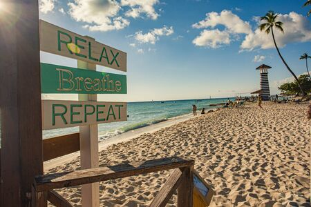 Relax Breathe Repeat sign in Dominicus beach