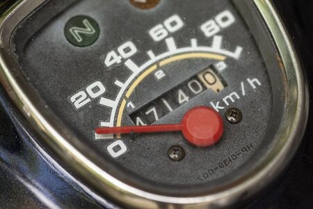 Odometer of a vintage motorcycle in a macro shoot