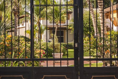 Gate on the tropical garden in Dominicus, Dominican Republic