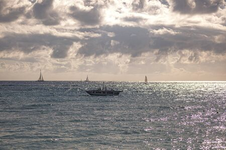 Boats on the sea on the horizon in Bayahibe, Dominican Republic