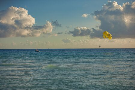 Paraglider in the sea at sunset in Dominicus