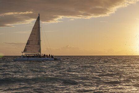 Catamaran on the sea at sunset in caribbean sea 版權商用圖片
