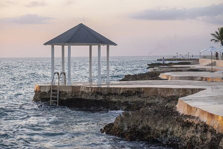 Dominican coast at sunset in Dominicus near Bayahibe 版權商用圖片