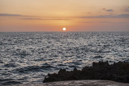 Sunset over the sea in the caribbean in Dominicus beach in Dominican Republic