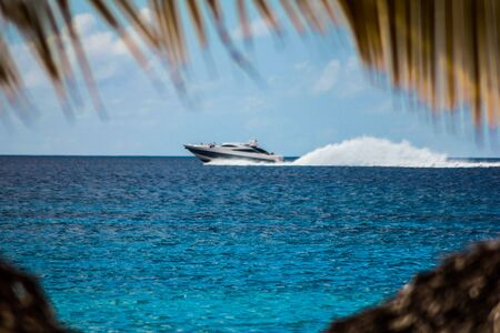 Motorboat speeds over the sea in the Dominicus coast in the Dominican Republic Stock Photo