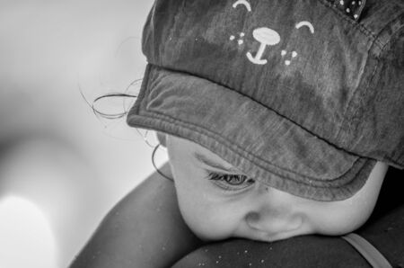 Innocent face of a child who looks down, Image Black and White