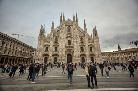 MILAN, ITALY 10 MARCH 2020: Milan Cathedral with tourists and people strolling en masse on the square