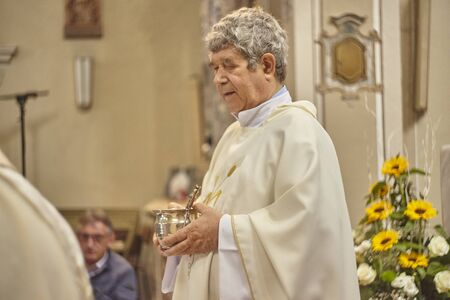 Priest celebrates the liturgy in a Catholic church in Italy