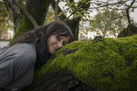 Portrait of a cute Woman in contact with nature with love