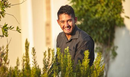 Portrait of a Mexican smiling boy immersed in nature at sunset
