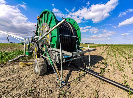 VILLANOVA DEL GHEBBO, ITALY 7 MAY 2020: Hose reel sprinkler in fields