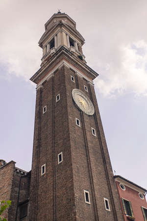 Deatil of Santi Apostoli bell tower in Venice in Italy