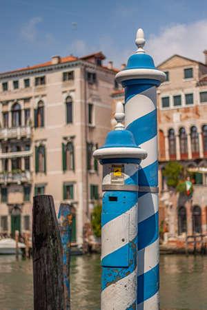Blue and white Colored pole in Venice, a symbol of Venice