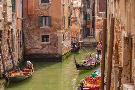 VENICE, ITALY 2 JULY 2020: Gondolier in Venice canal Redakční