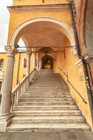 FERRARA, ITALY 29 JULY 2020: Stairway of honor in Ferrara a famuos historic staircase of town hall building in Italy Editorial