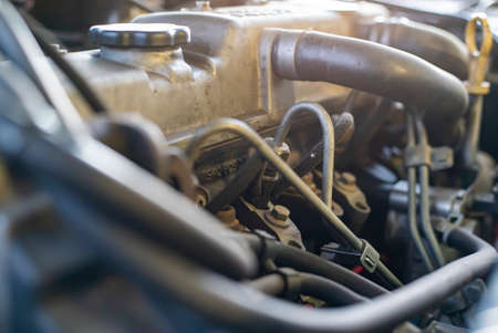 Detail of the diesel injectors in a car engine being repaired