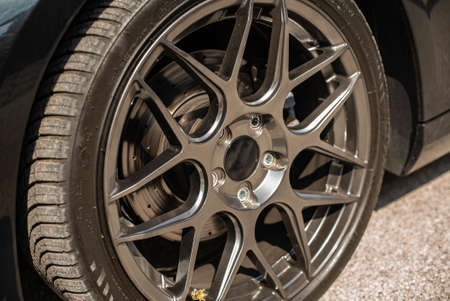 Detail of generic Aftermarket tuning sports rim and wheel