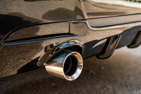 Detail of Chrome car tuning exhaust on the street