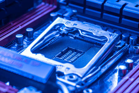LOS ANGELES, USA 25 APRIL 2021: Detail of a Cpu socket in a motherboard of a gaming pc in bluie light Editorial