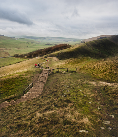 A path runs through the Peak District from Mam Tor on a windy winters day Banco de Imagens