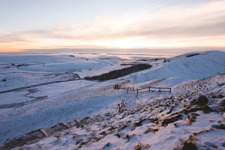 Mam tor covered in Snow during Sunset in the Peak District Stock Photo