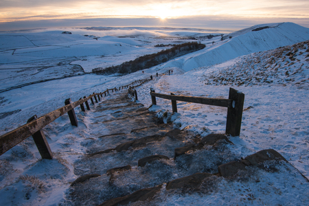 Mam tor covered in Snow during Sunset in the Peak District