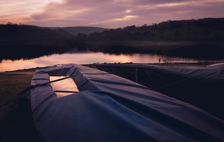 Sailing boat under cover 版權商用圖片