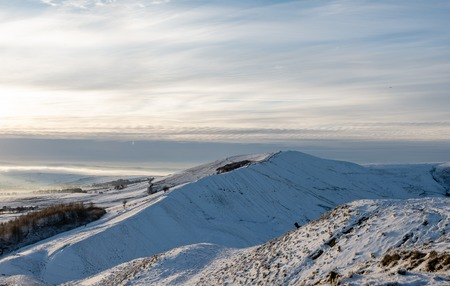 Mam Tor, the snowy hill in the Peak District on a cold morning in January, 2019