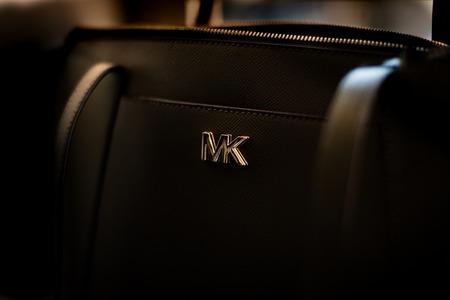 Isolated close up of a black Michael Kors handbagand logo