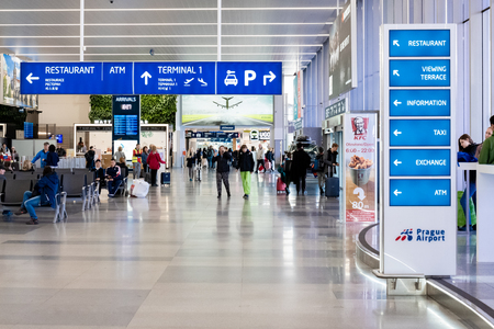 PRAGUE, CZECHIA - 9TH APRIL 2019: Arrivals area of Prague international airport - Signs pointing tourists to their intentended locations