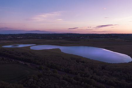 Aerial shot of Sunset over Waverley Lake, Rotherham, South Yorkshire