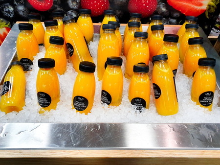 SHEFFIELD, UK - 31ST MAY 2019: Bottles of fresh orange juice on sale from Marks and Spencers on sale in Meadowhall