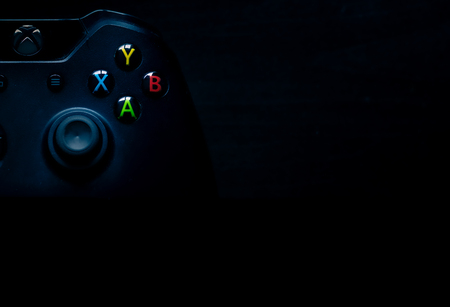 The Xbox one controller sits in the corner of the image as presentation material Banco de Imagens - 124913144