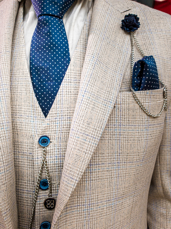 Latest trends in Suit, shirt and tie combination - White suit and tie - Navy Tie