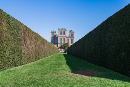 DERBYSHIRE, UK -21ST APRIL 2019: A view of the famous Hardwick Hall from the stunning gardens. Taken in Early Spring 2019 Editorial