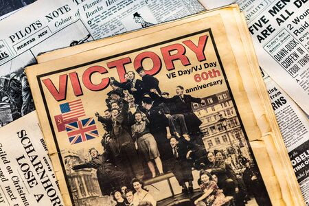 DONCASTER, UK - 28TH JULY 2019: Newspapers from World War Two with headlines of Victory in Europe (VE Day)