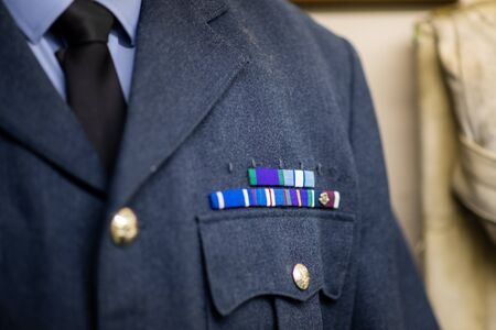 DONCASTER, UK - 28TH JULY 2019: A RAF uniform from World War 2 on display at Doncaster Aviation Museum with ribbons and medals