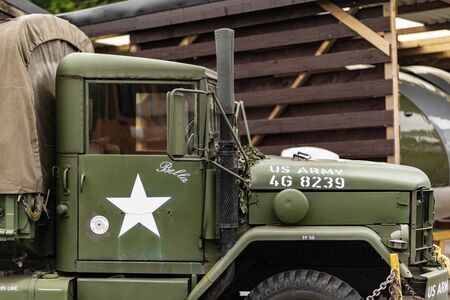 DONCASTER, UK - 28TH JULY 2019: A close up of a green and brown M35 army cargo truck used during world war 2