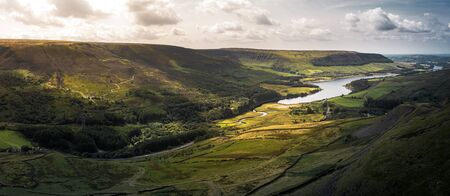 Stunning aerial panoramic shot of the Peak District National Park at the Woodhead to Torside reservoirs showing the streams of water connecting the two