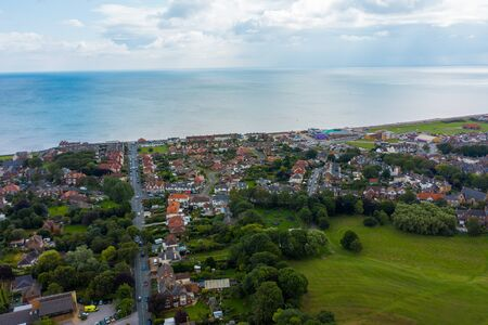 Aerial View of buildings and the mere in the seaside town of Hornsea during Summer of 2019